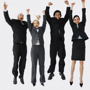 Front view portrait of four business executives jumping with arms raised