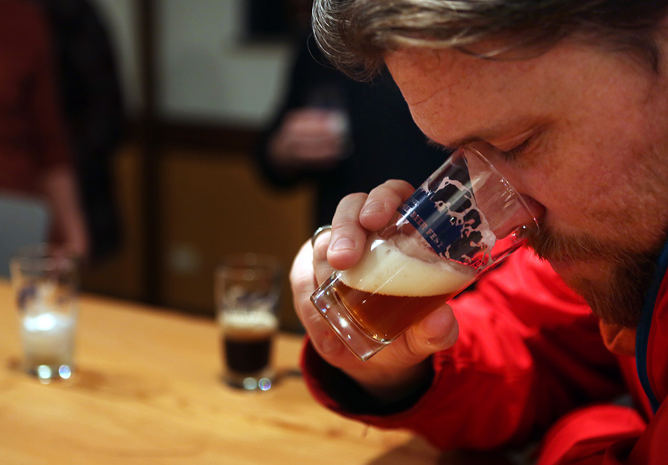 Peter Campbell smells a sample of the Dangerous Man Brewing Co. IPA in Minneapolis, Minn. Thursday, Jan. 10, 2013. Dangerous Man will offer four beers, served in either pints or growlers, when it opens later in Jan., 2013.